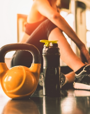 close-up-kettlebells-with-woman-exercise-workout-gym-fitness-breaking-relax-after-sport
