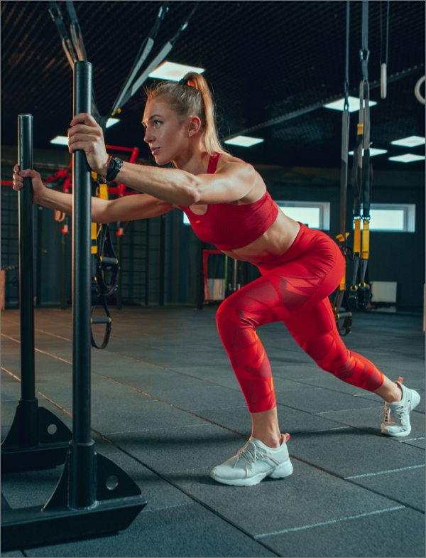 young muscular woman practicing gym